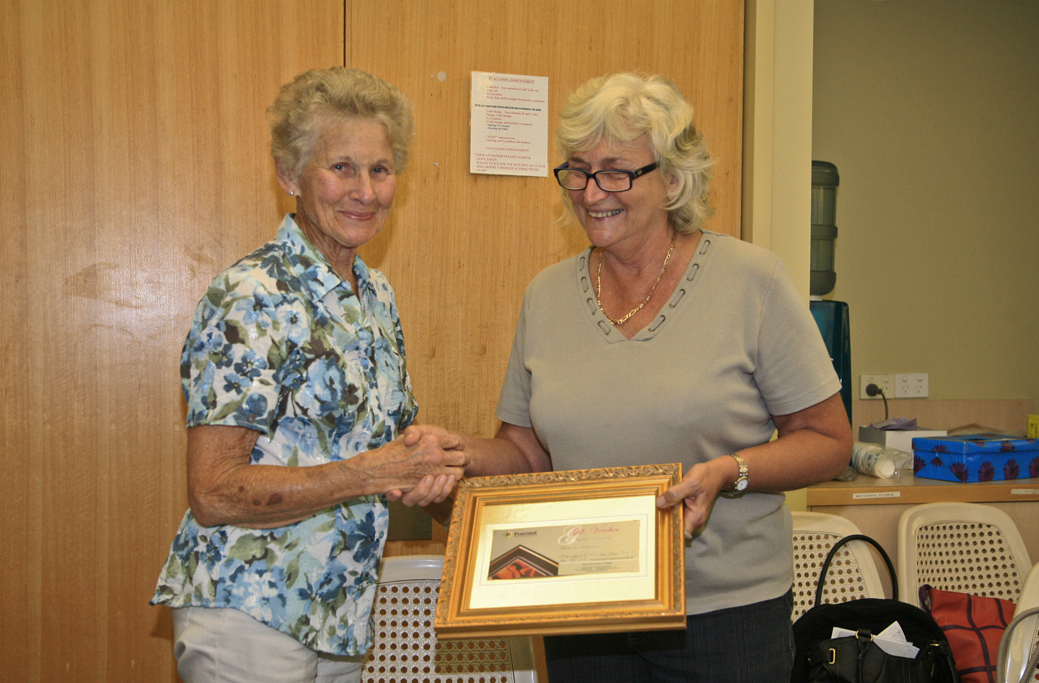 President Helen Craig presenting Margaret Brown with her award
