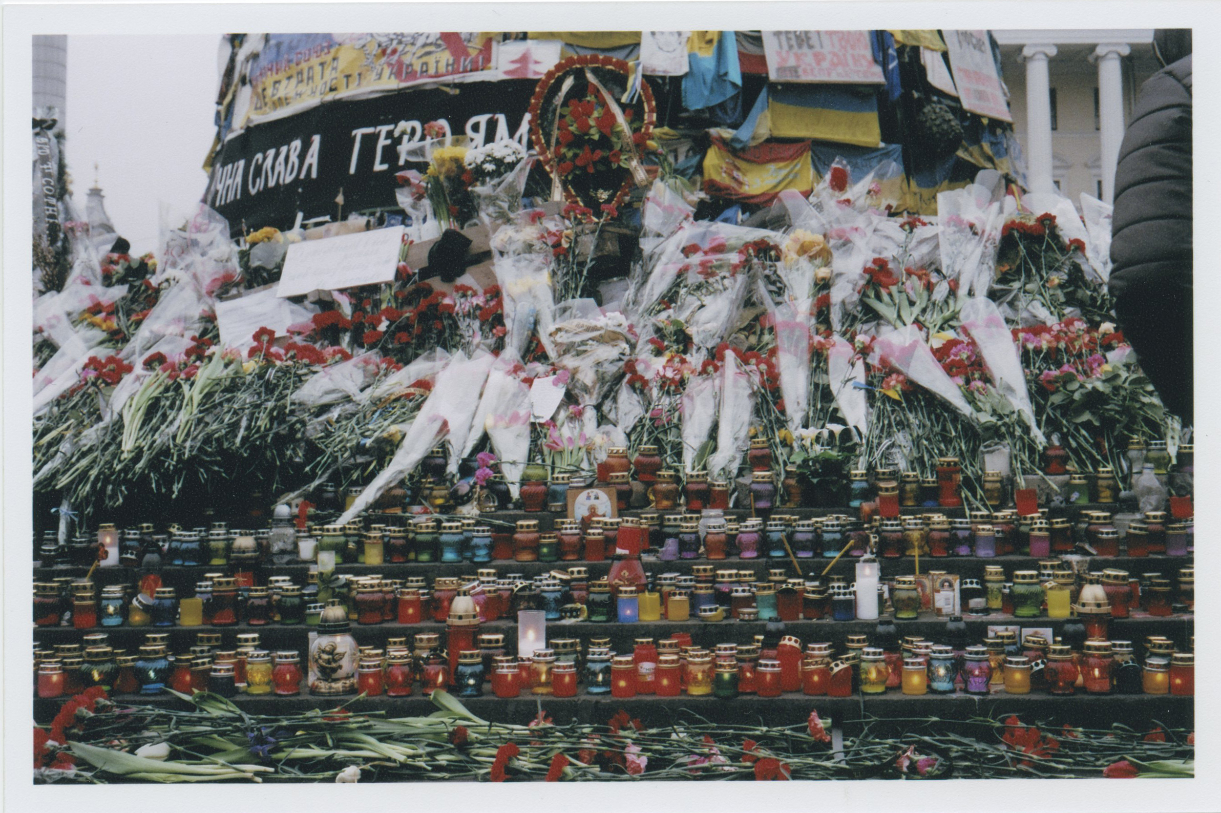 Thousands of votive candles and flowers filled Maidan. The entire city center become a giant memorial to the 103 protestors who were killed, and the 1528 who were injured. Between 150 and 500 people are still missing, and many of those people and bodies will never be recovered. It is devastating.    Photo: Michael Berlucchi