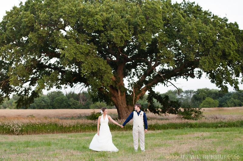 34.+bride_groom_tree_holding_hands.jpg