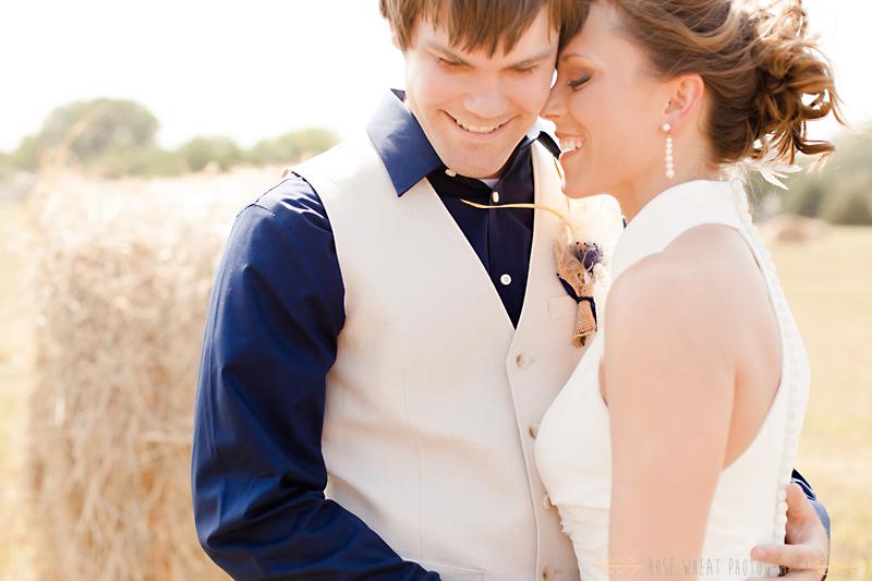 24.--bride_groom_portraits_hay_bail-2.png