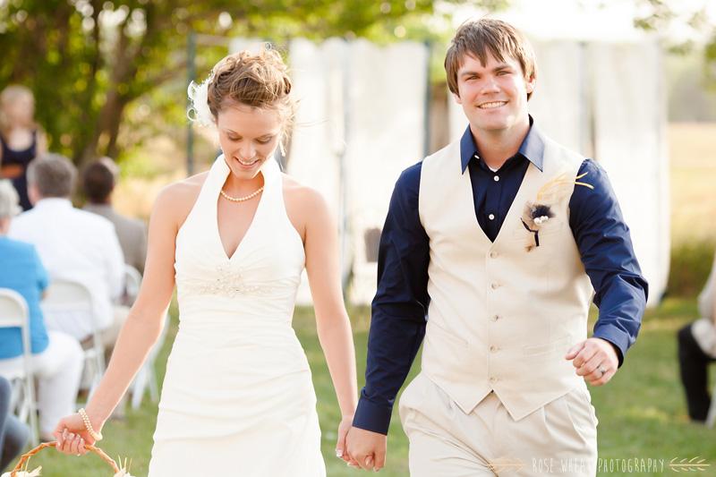 31.+bride_groom_kiss_aisle-2.jpg