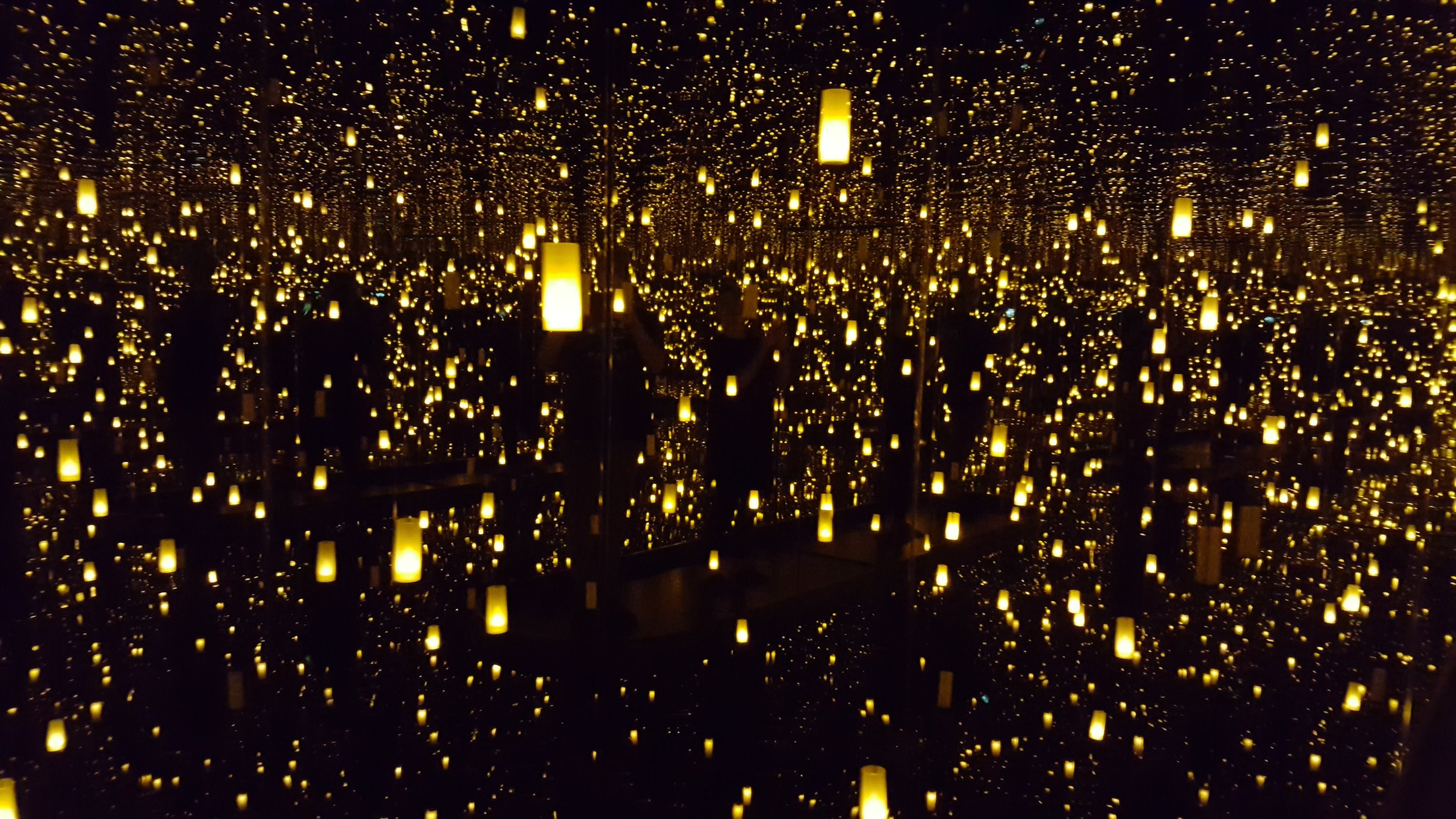 Yayoi Kusama,  Infinity Mirror Room—Aftermath of Obliteration of Eternity (2009),represented by lanterns that seem to extend into infinite space.