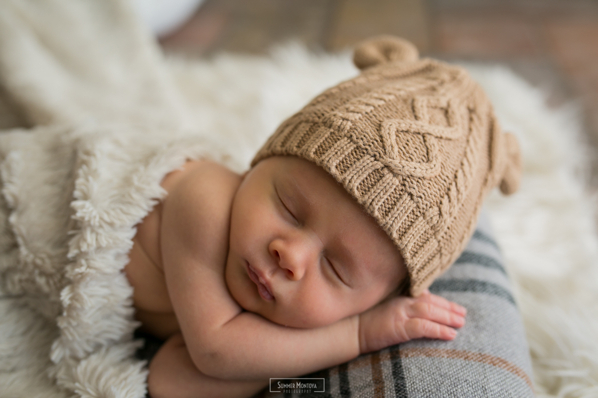 Newborn baby boy, in home photo shoot.