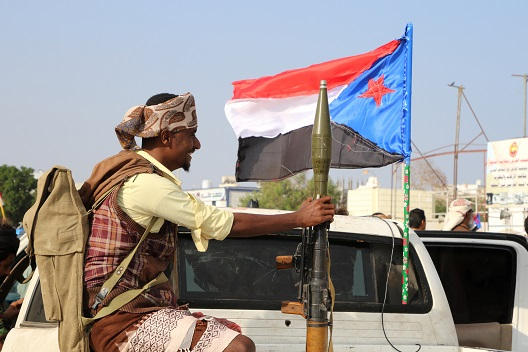 Photo: A bodyguard of a southern Yemeni separatist leader holds an RPG launcher as he rides on the back of a pick-up truck at the site of an anti-government protest in Aden, Yemen January 28, 2018. REUTERS/Fawaz Salman