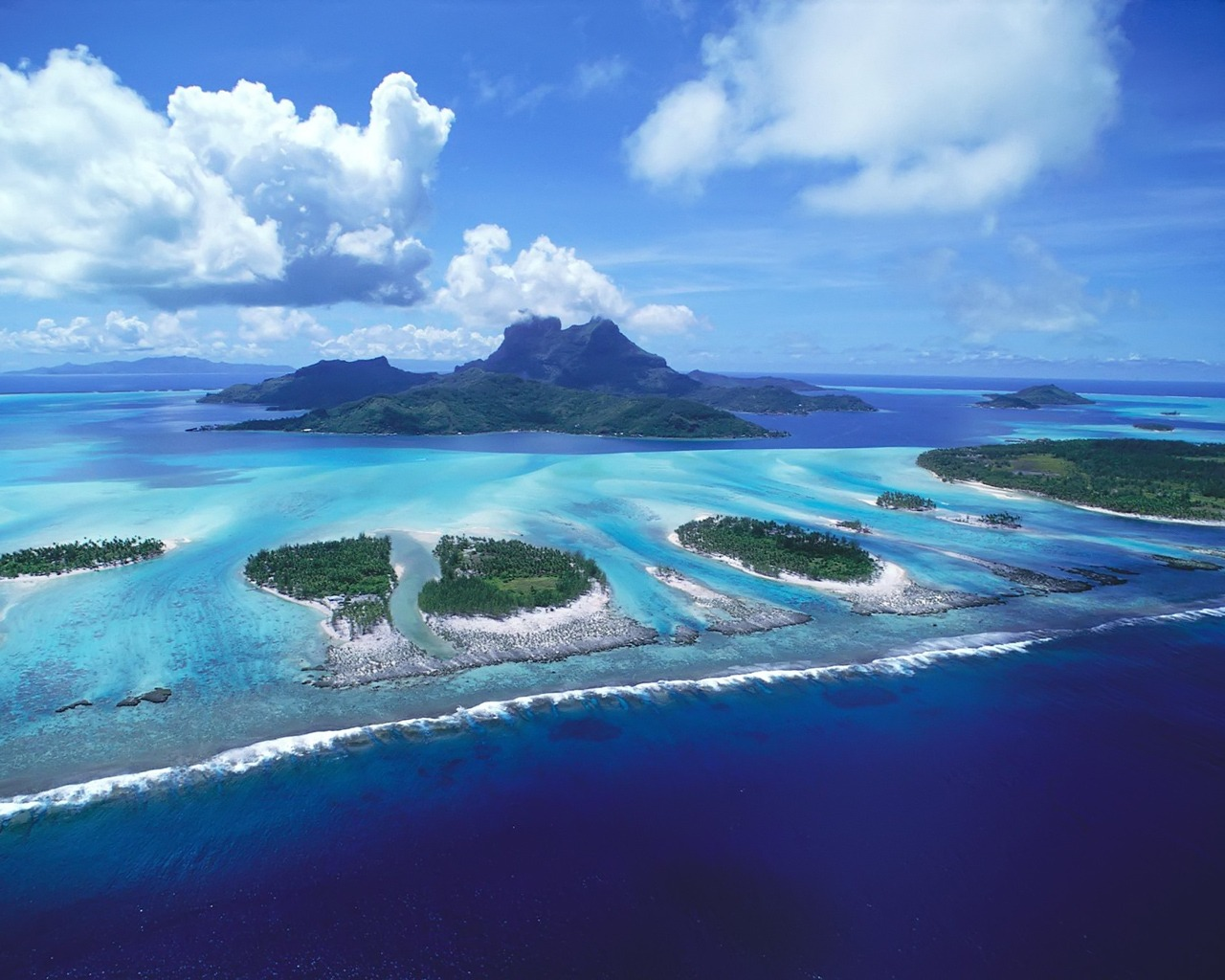 Bora Bora, The Romantic Island  Under a one hour flight from the island of Tahiti or Moorea, the island of Bora Bora, with a lagoon resembling an artist's palette of blues and greens, is love at first sight. Romantics from around the world have laid claim to this island where the castle-like Mount Otemanu pierces the sky. Lush tropical slopes and valleys blossom with hibiscus, while palm-covered motu circle the illuminated lagoon like a delicate necklace. Perfect white-sand beaches give way to emerald waters where colored fish animate the coral gardens as they greet the giant manta rays. This could be easily be described as the center of the romantic universe, where luxury resorts and spas dot the island with overwater bungalows, thatchedroof villas, and fabled ambience.   Romance on Bora Bora    Truly, the most romantic island in the world. From the dramatic scenery to the privacy and amenities of the overwater bungalows, everything in Bora Bora equals a 10 on the romance scale. Resorts have been welcoming couples for over 40 years and their special amenities have been fine tuned to perfection. From sunrise to sunset, each resort has designed their own blend of unique romantic experiences for their guests to choose from.