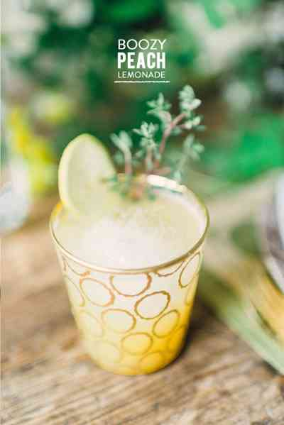 Boozy Peach Lemonade from Waiting on Martha  photographed by  Rustic White  via  Style Me Pretty