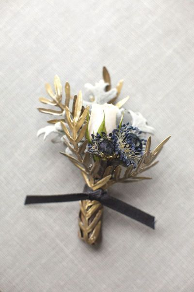 Navy & gold boutonniere from  Mindy Rice  by  Aaron Delesie  via  Style Me Pretty
