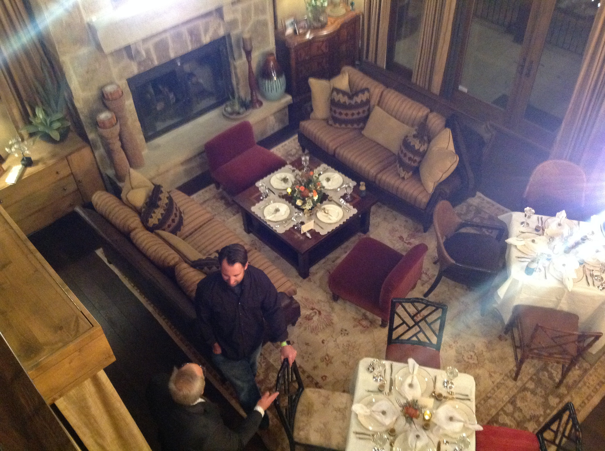 An overview of the living room finds Jamie Allen with host Bob Branden.