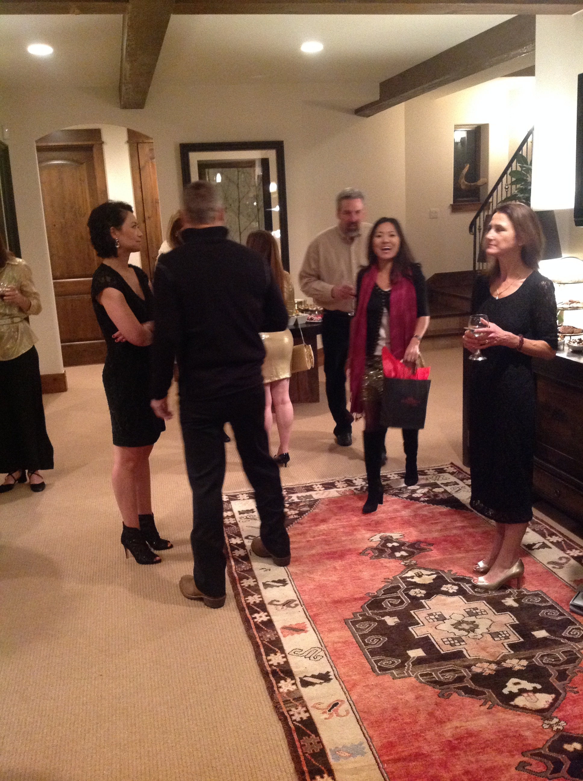 Tsering Elmblad arrives in the lower area of the home where guests congregate before dinner.
