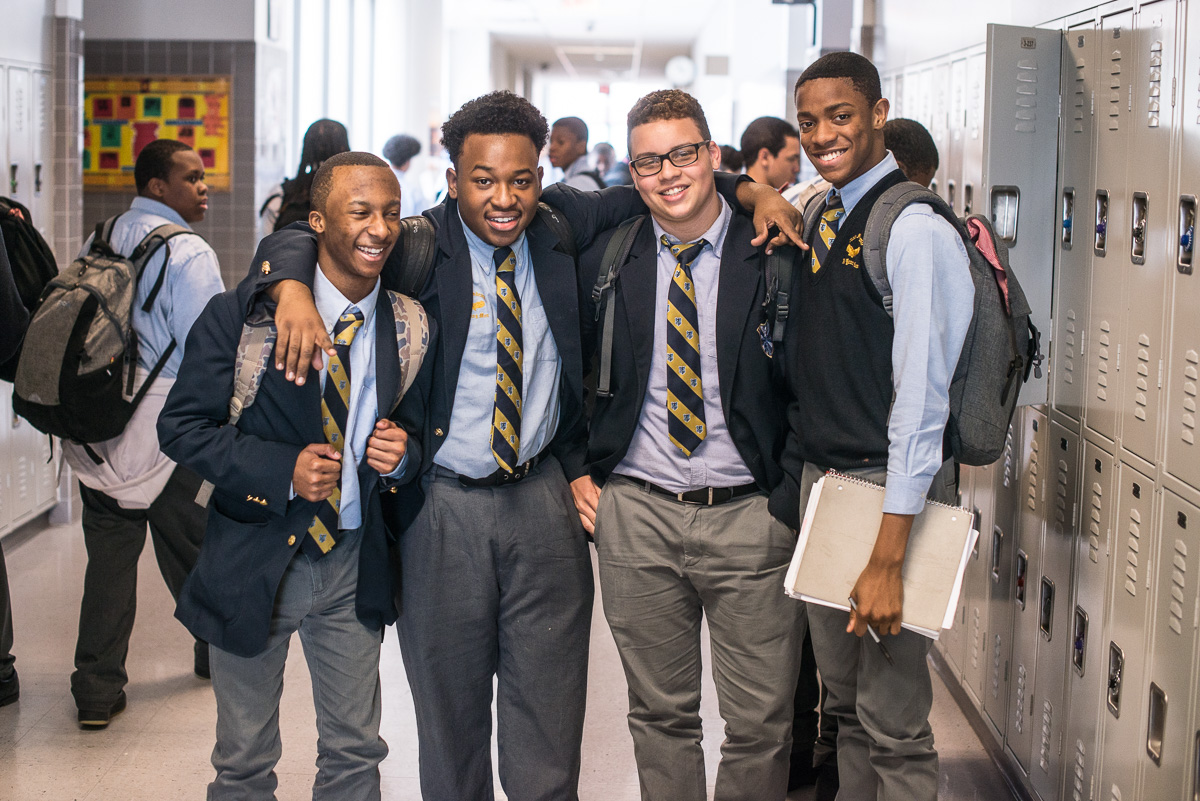 Boys laugh in between classes at Eagle Academy