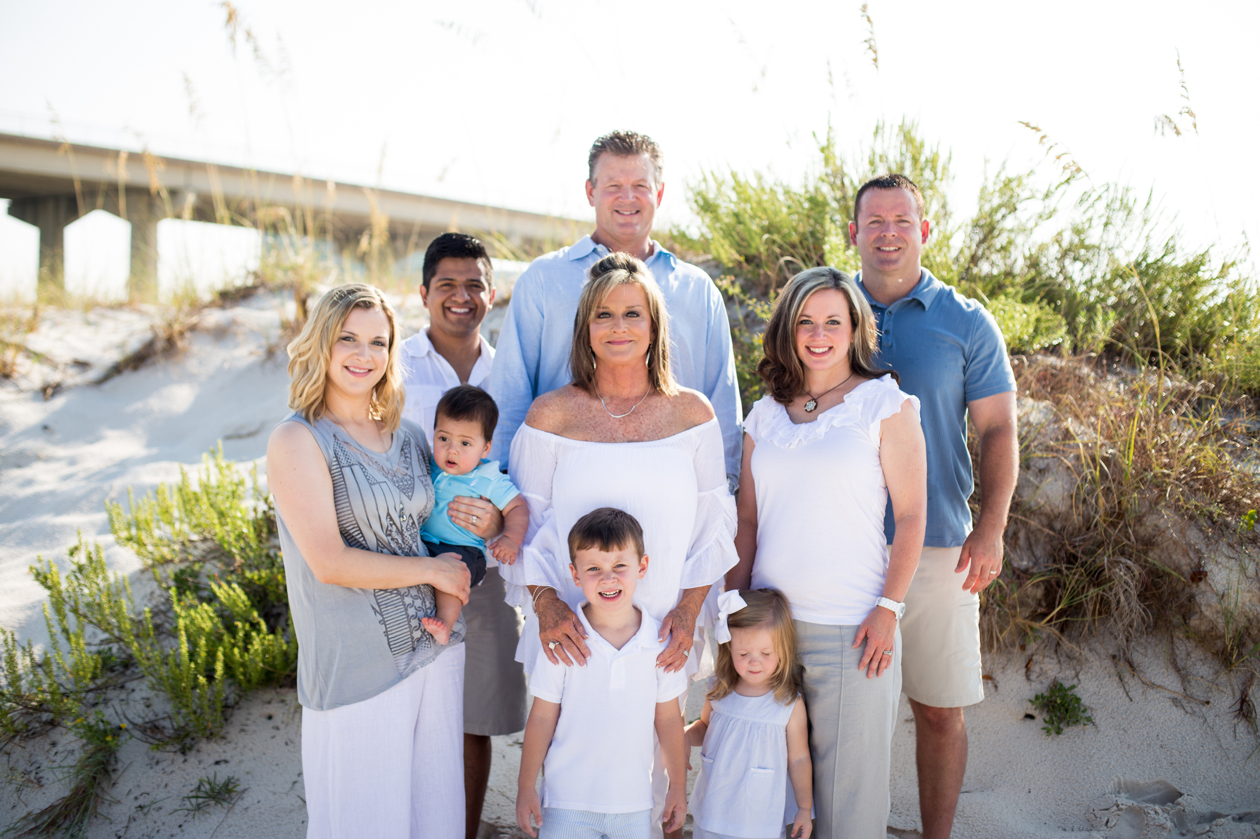 The Wallace family adds in pops of light & darker blues & grays to contrast the white & khaki. Beautiful family!!