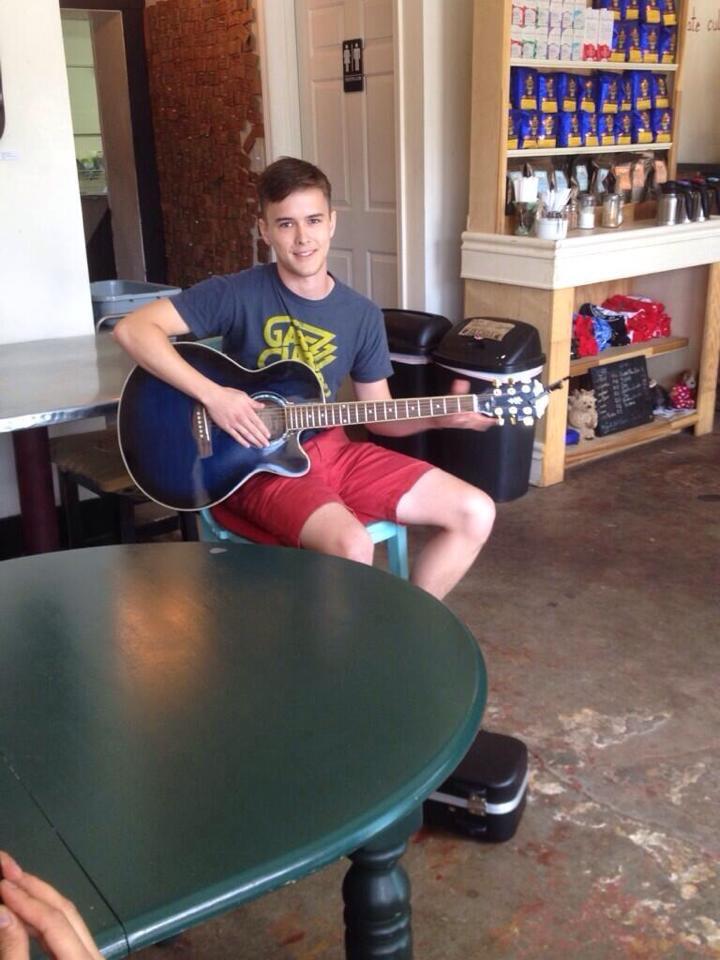 Zachariah serenading the shop one Saturday morning.