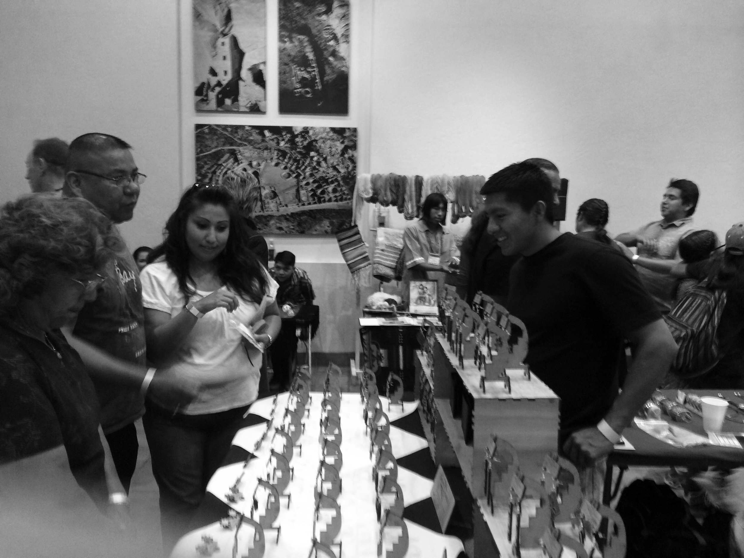 Engaging with customers. Me (Mike Adams) to the right. All the beautiful stands on the table.