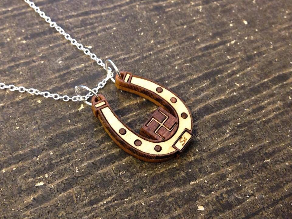 """""""I love my custom horseshoe piece that was created by GourdJewels. Mike captured the essence of what I was looking fir in a piece of jewelry to call my own. I love it because not only does it express me, but also carries family history within my piece. My pendant is lightweight, personalized, and the richness of the wood grain matches well. I can wear this piece anytime and often get comments about where I got something like that so unique! Thanks GourdJewels. -Simana, Polacca, AZ."""