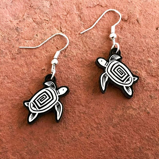 These Sea Turtle earrings are designed with symbols of prayer and long life.  Since each animal carries a special power, that same energy was created with the grace of the sea turtle in mind.  The sea turtle represents grace and wisdom.  Own or gift this amazing signature piece with its unique design and carefully crafted detail.  Each pair is precision engraved on a metallic aluminum finish and paired to a Alder wood backing.  Since the earring is primarily wood, they are extremely lightweight.  Each pair comes with a custom designed hanger and box. . . . . . . . . . . #turtles #babyturtle #seaturtle #ocean #turtlelove #turtle #turtlelife #turtlepower #earrings #earring #earringsoftheday #jewelry #fashion #accessories #earringsforsale #earringaddict #earringstagram #fashionista #cute #gorgeous #trendy #earringswag #earringfashion #earringlove #woodenearrings #statementearrings #indeginousart #woodenjewelry #inspiredbynature #GourdJewels