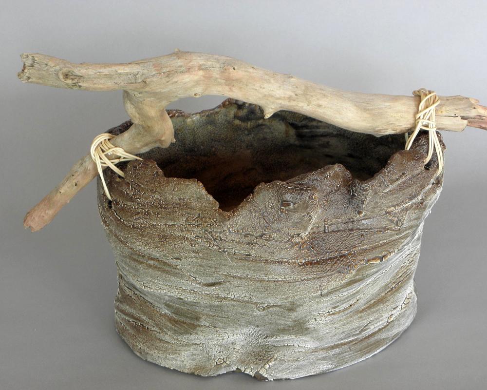 handmade ikebana vase with driftwood