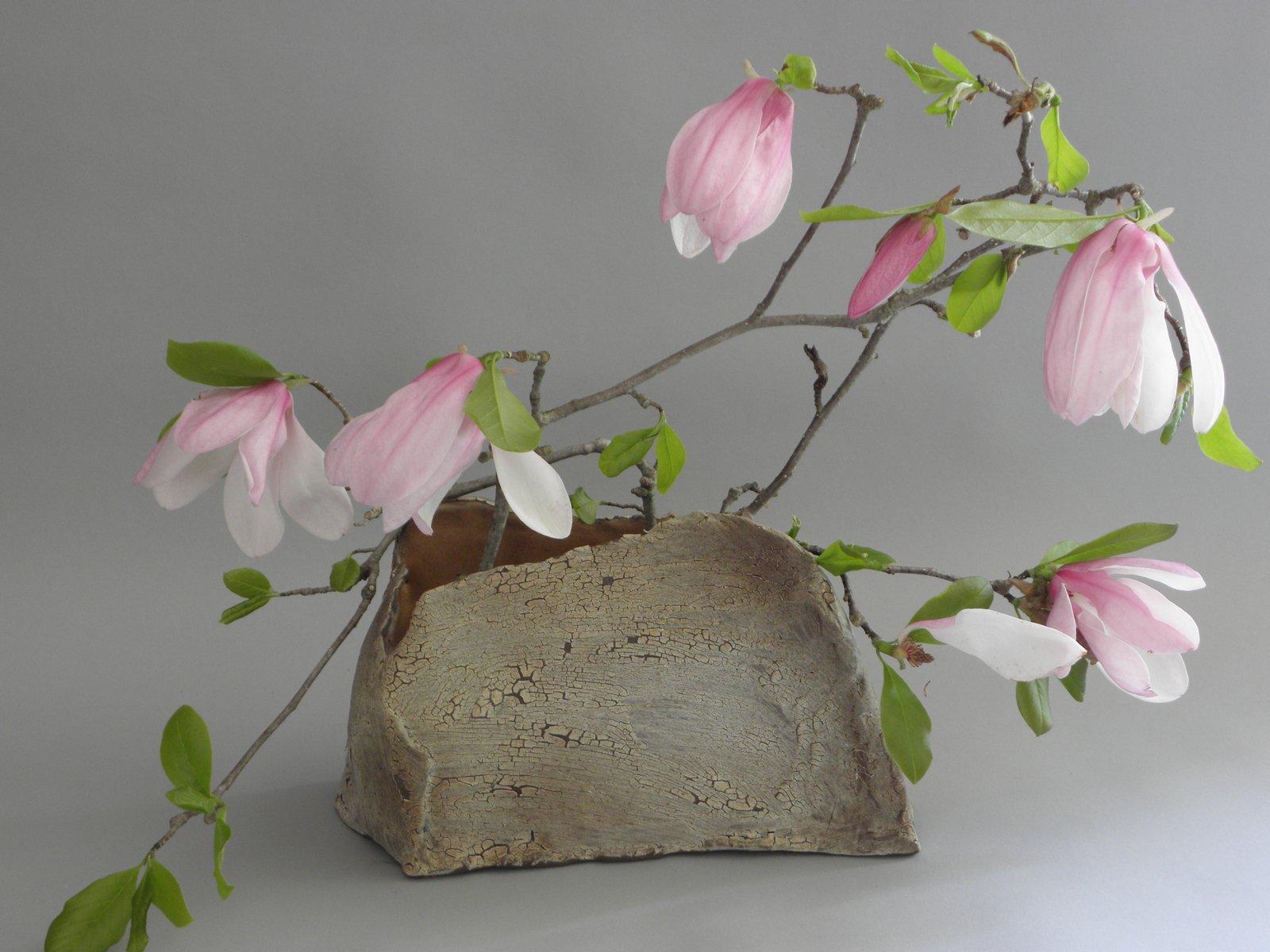 ikebana vase with arrangement
