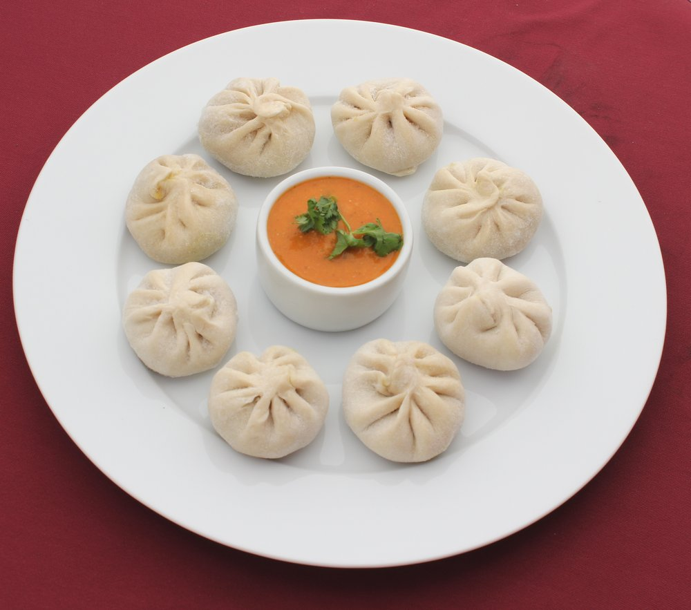 """Momo"" is a Nepali steamed savory dough dumpling snack.  The dumplings are stuffed with tofu, vegetables, local cheeses and sometimes meat."