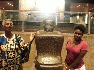 - Catherine Carr and Sawdayah Brownlee with a New Kingdom Scribe at the Nubian Museum, Aswan. Elder Mother Carr took the journey as a gift from her family to celebrate her 80th birth year, and accompanied by her daughter, Gussie, named for her mother's mother. Her grandson, Ellington Fuller, Gussie's son, completed his first journey to Africa and to Kemet with HU Study Abroad Kemet in 2018.