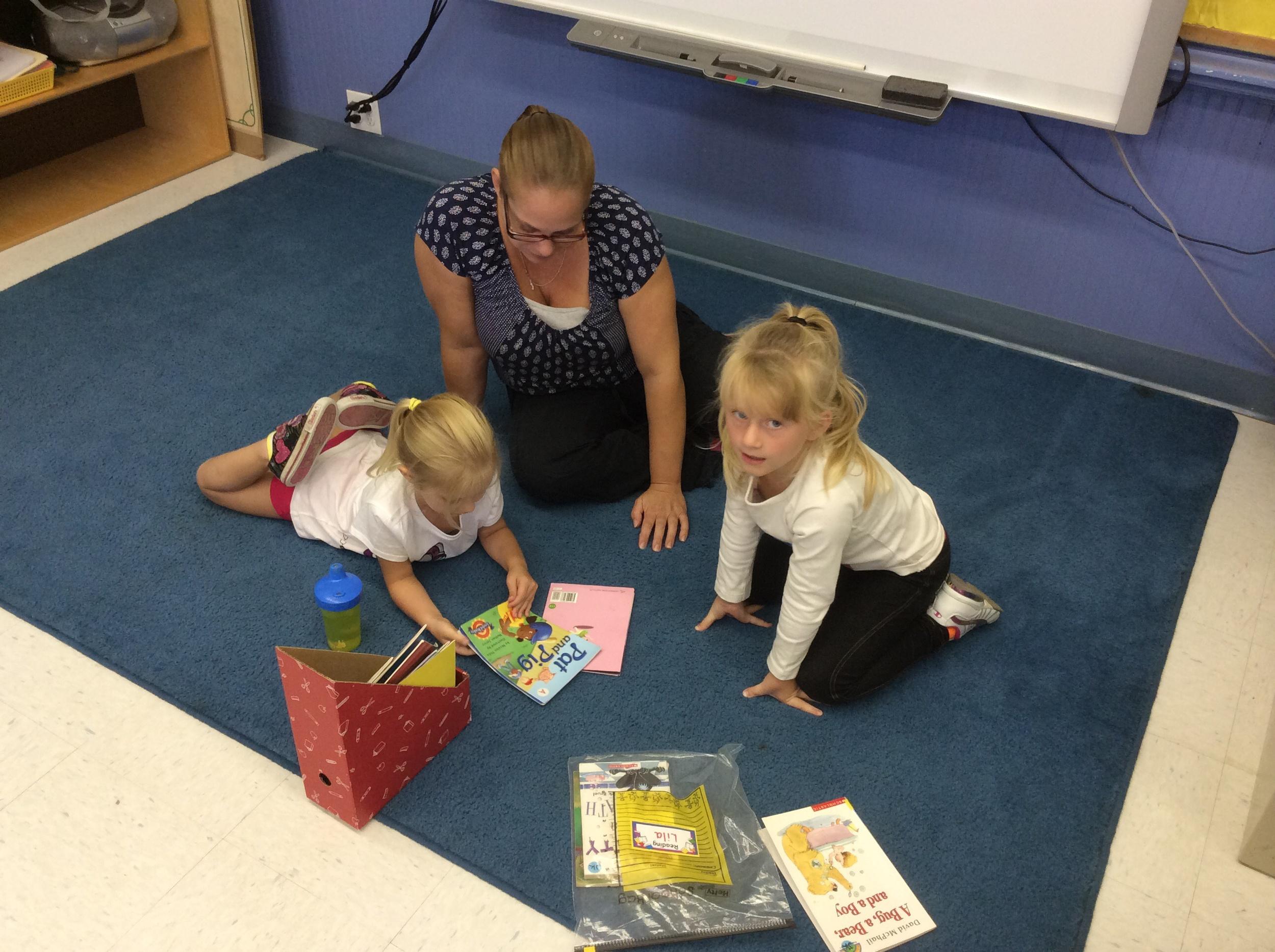 Mrs. Szymczak enjoyed reading groups with our primary group!