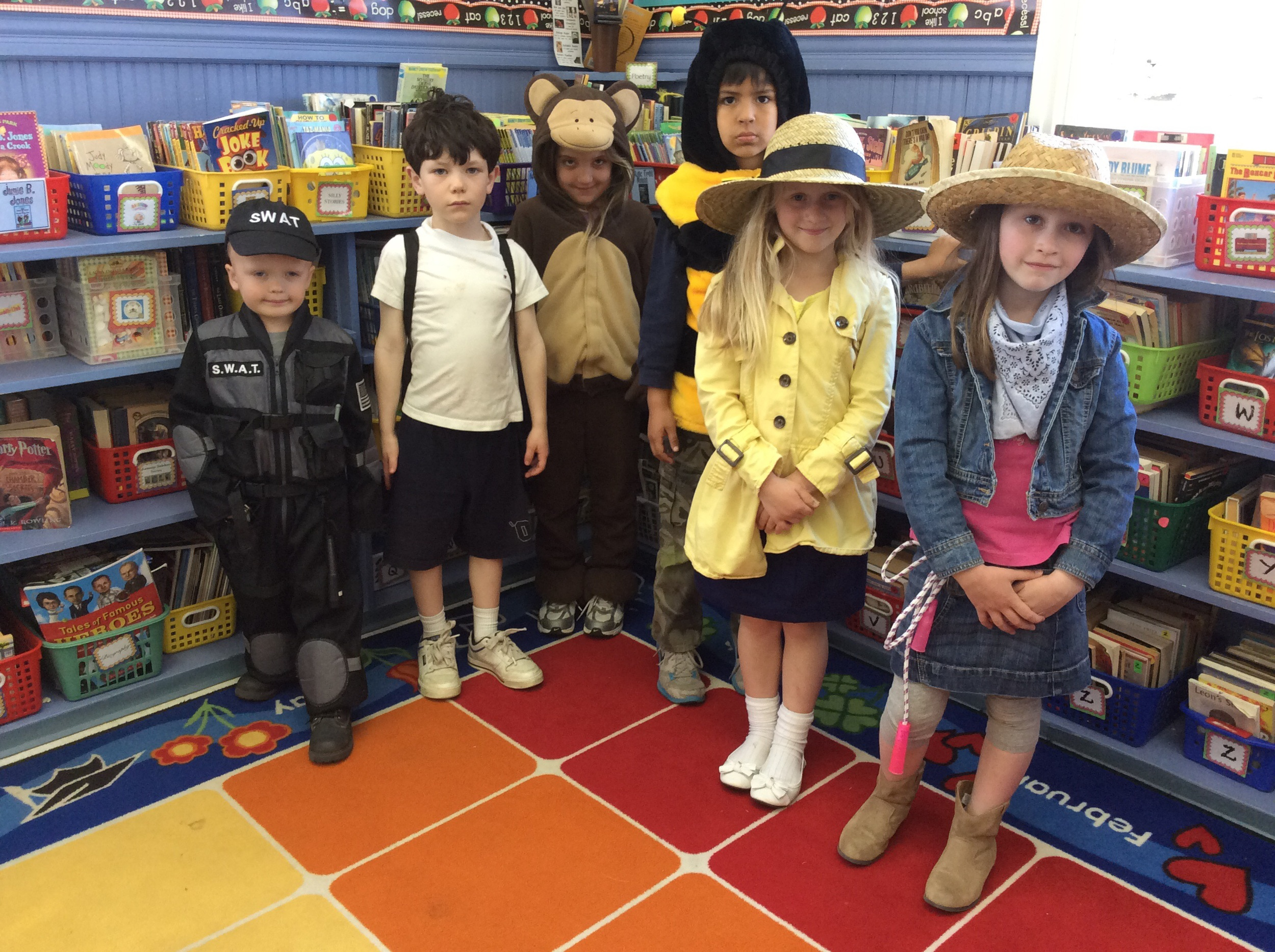 Left to right: Chance McCain from Lego City, Diary of a Wimpy Kid's Greg, Curious George, Fly Guy, Madeline, and Andrea from Big Apple Barn