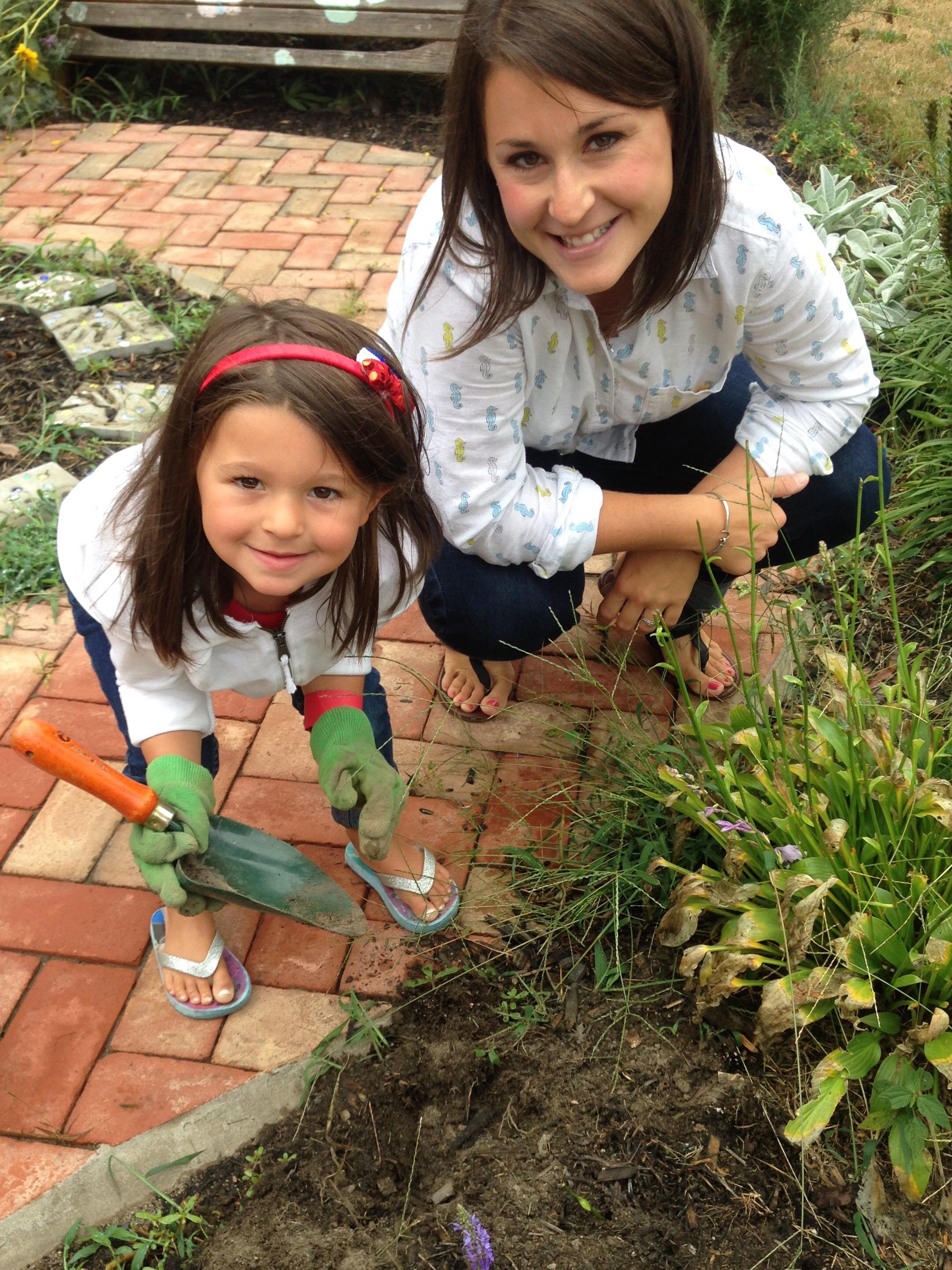 Mrs. Pollina and Alexa work in the Centennial Garden