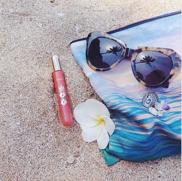 pictured: Leilani Bishop Fragrances  Orange Blossom rollerball  on the beach in Hawaii