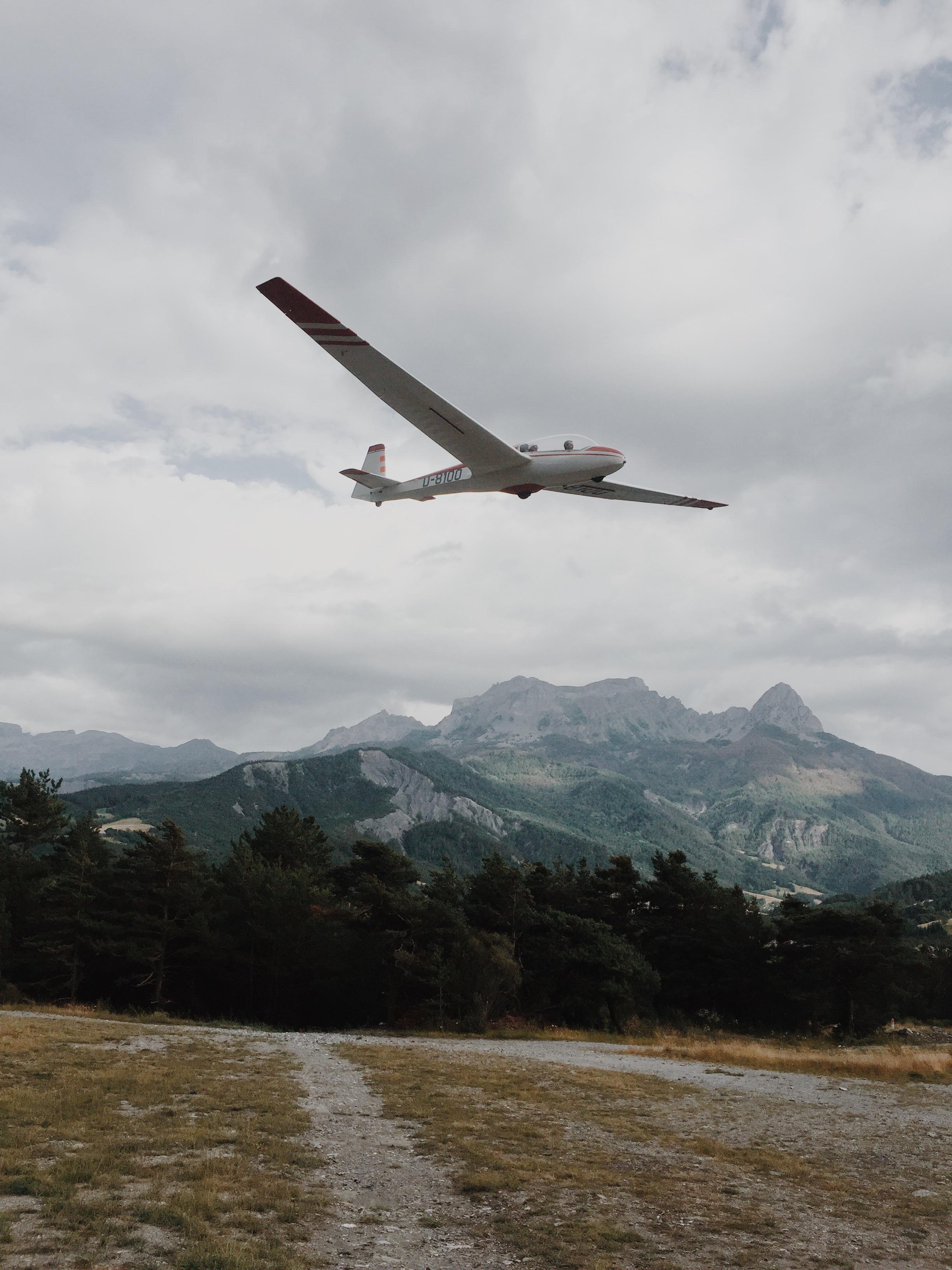 Glider plane landing at Saint-Pons Airport, Barcelonnette, France