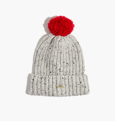 """""""I've been conflicted about pom pom hats forever...pretty much. Childish? Usually. But somehow this one, with its flecked yarn and contrasting pom, really got me. I also rely heavily on hats this time of year as my stand-in for scarves on bad hair days."""" - Olivia"""
