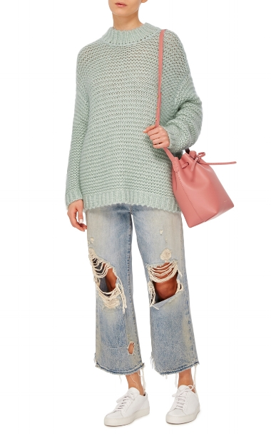 """""""I fell in love with this beautiful sweater when  Paulina  (above) showed up in it for our day with her (hers was cream, but I'm loving this pretty pale green)."""" -Coco"""