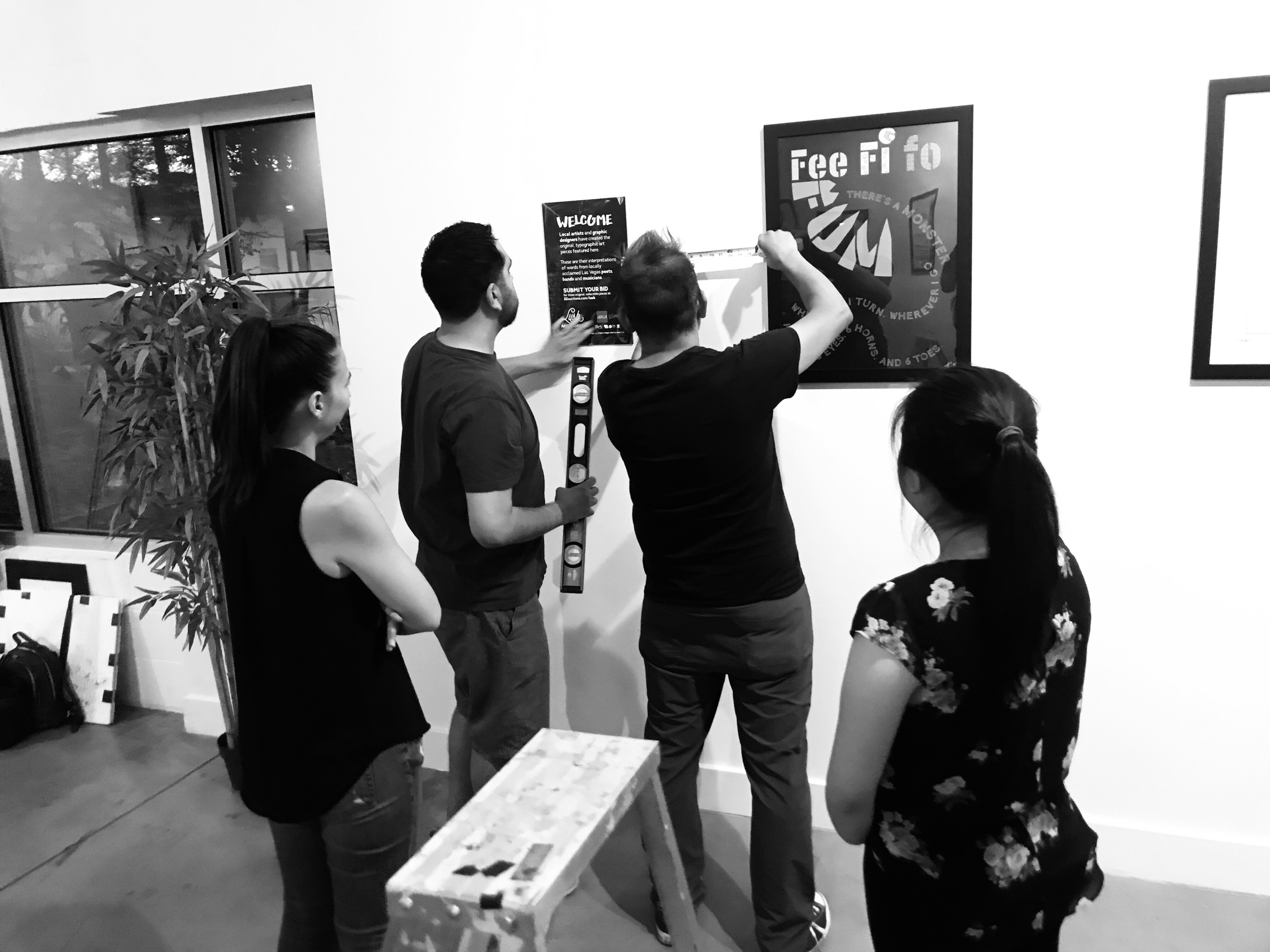 AIGA LV Board of Directors Jennie Marsh, Juan Beltran, AIGA Program Director and Editor In Chief of VIM Magazine Jorge Lara, and Therese Bautista setting up at Escape Artist Studios.