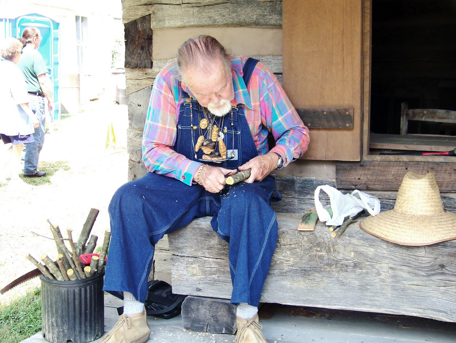 Whittling-on-the-porch-of-the-Payne-cabin-at-the-2008-Mountain-Marketplace-Festival.jpg