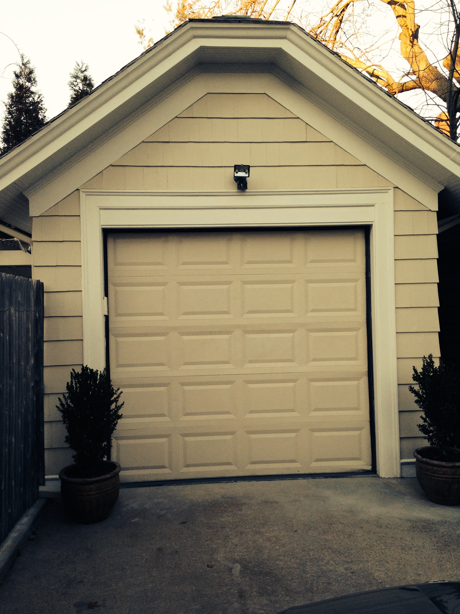 this is the garage door that came with the purchase of the house; it had to go to increase the size of the yard.