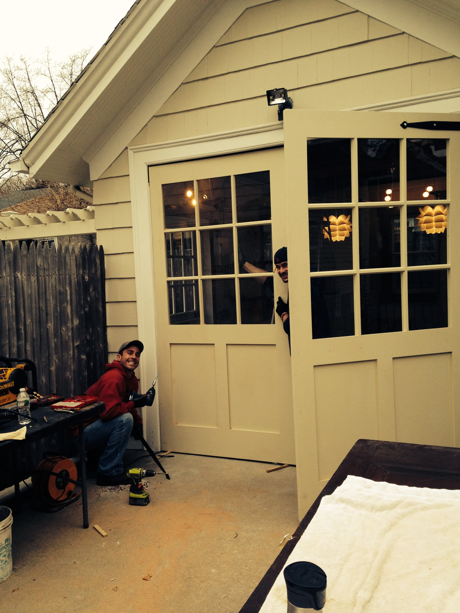 Custom Carriage Doors from Uxbridge, MA set the stage for a new outdoor dining area.