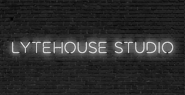 Lytehouse+White+Logo+on+Brick+(1).png