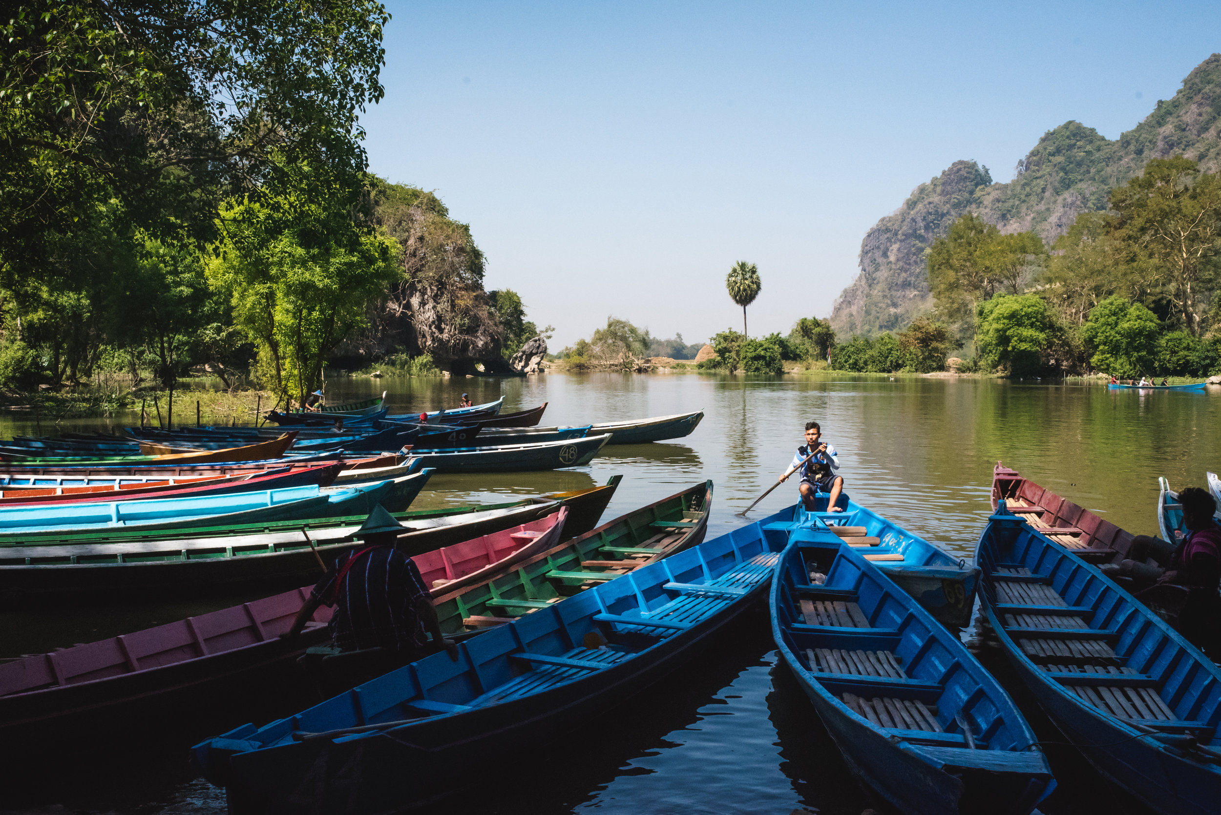 If you go to Sadan Cave, carry your shoes with you so that you can take one of these boats back to the parking lot without burning your feet. Literally—our friend stepped on a lit cigarette on the path.