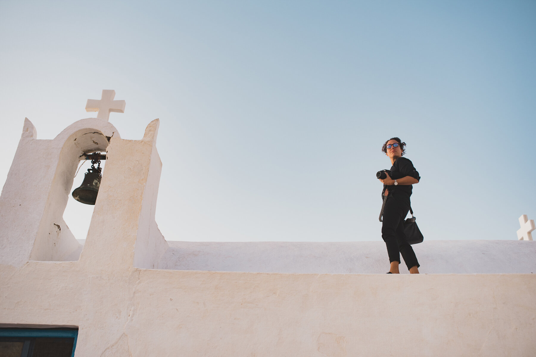 photographer on Santorini church