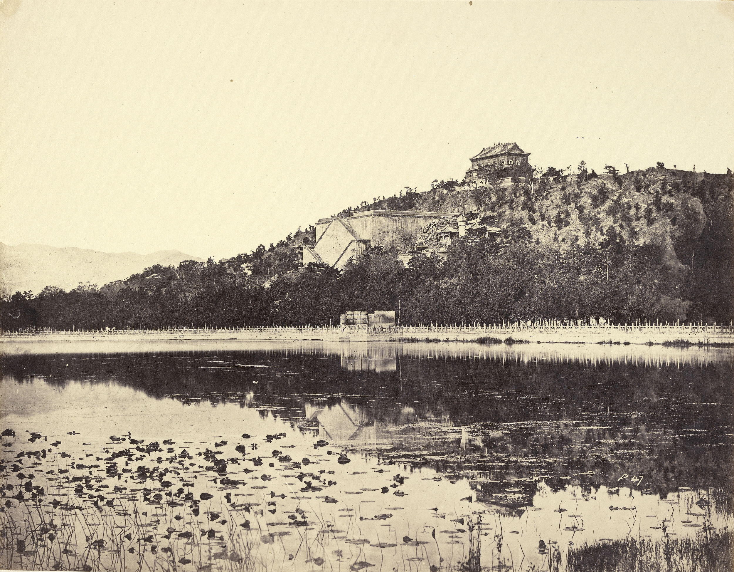View of the Imperial Summer Palace, Yuen-Ming-Yuen, after the Burning, Taken from the Lake, Peking, 1860, Albumen silver print, 23.2 x 29.8 cm. The J. Paul Getty Museum, Los Angeles