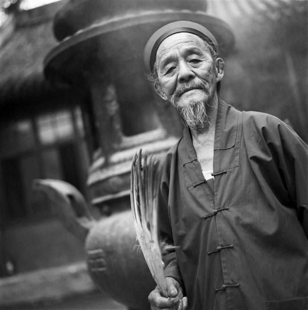 A Taoist Priest Holding Fan, Beijing, 1994, Archival inkjet print