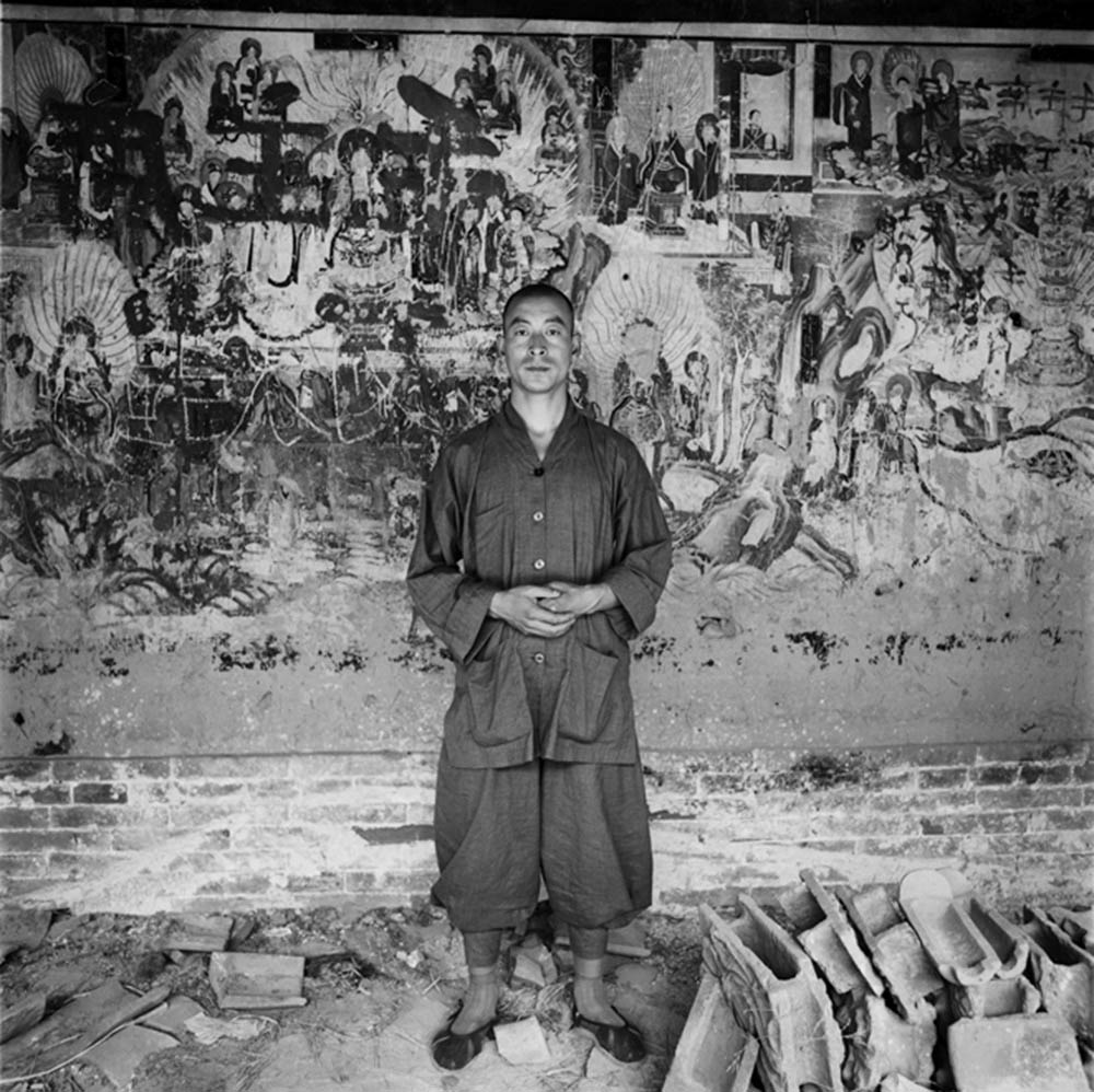 A Young Monk in Front of Ancient Mural, Lingqiu, Shanxi Province, 1996, Archival inkjet print
