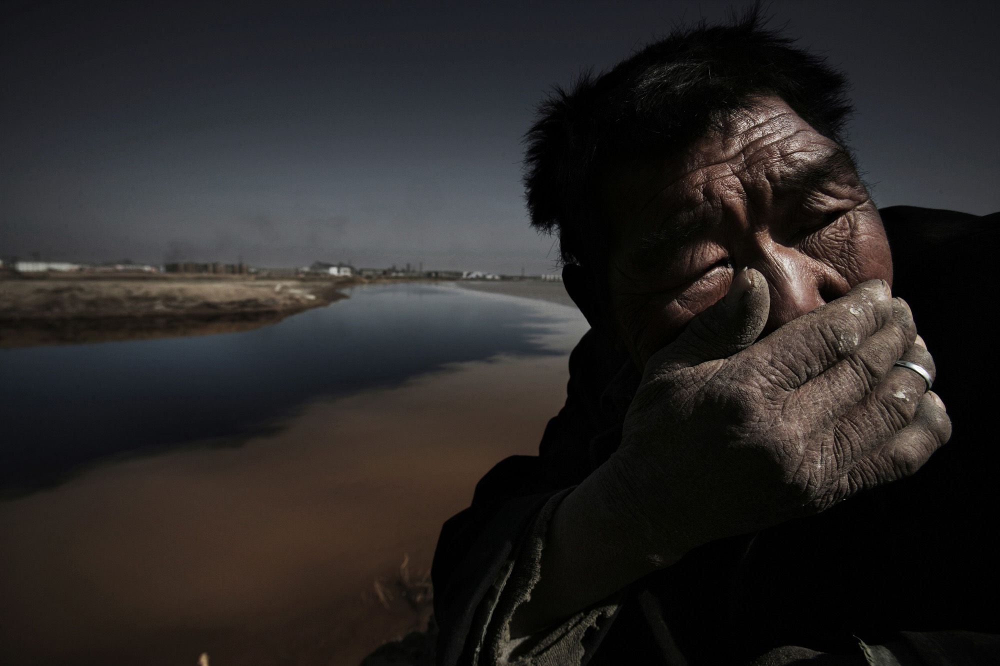 "Lu Guang, ""Shepherd on the bank of the Yellow River. Shizuishan City, Ningxia"", April 23, 2006"