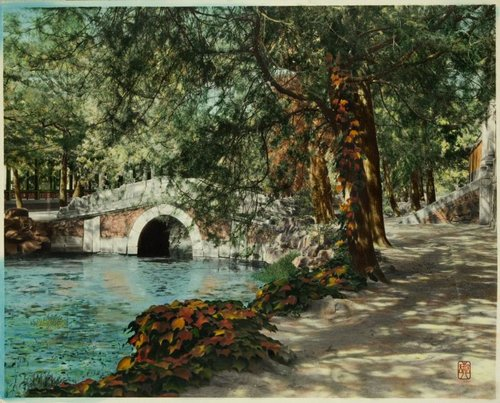 """Bridge, Summer Palace, Beijing,before 1927,Tinted photograph.Object Number:B60M518 © Asian Art Museum Chong-Moon Lee Center for Asian Art and Culture  This photograph shows two of the many picturesque bridges in the lake at the Summer Palace complex outside Beijing. Built in 1750 for the Qing dynasty's Qianlong emperor (r. 1735–1796), this complex comprises palaces, temples, pavilions, and gardens situated on and around Longevity Hill and the manmade Kunming Lake. The lake occupies more than threequarters of the total complex area. Bridges of different shapes and sizes connect the artificial islands on the southern part of the lake. The islands and shores separate the lake into sections in which were created different views referring to scenic locations elsewhere in China. This treatment of landscape gardening exemplifies a practice made famous by the Qing emperors—that of """"borrowing a scene."""""""