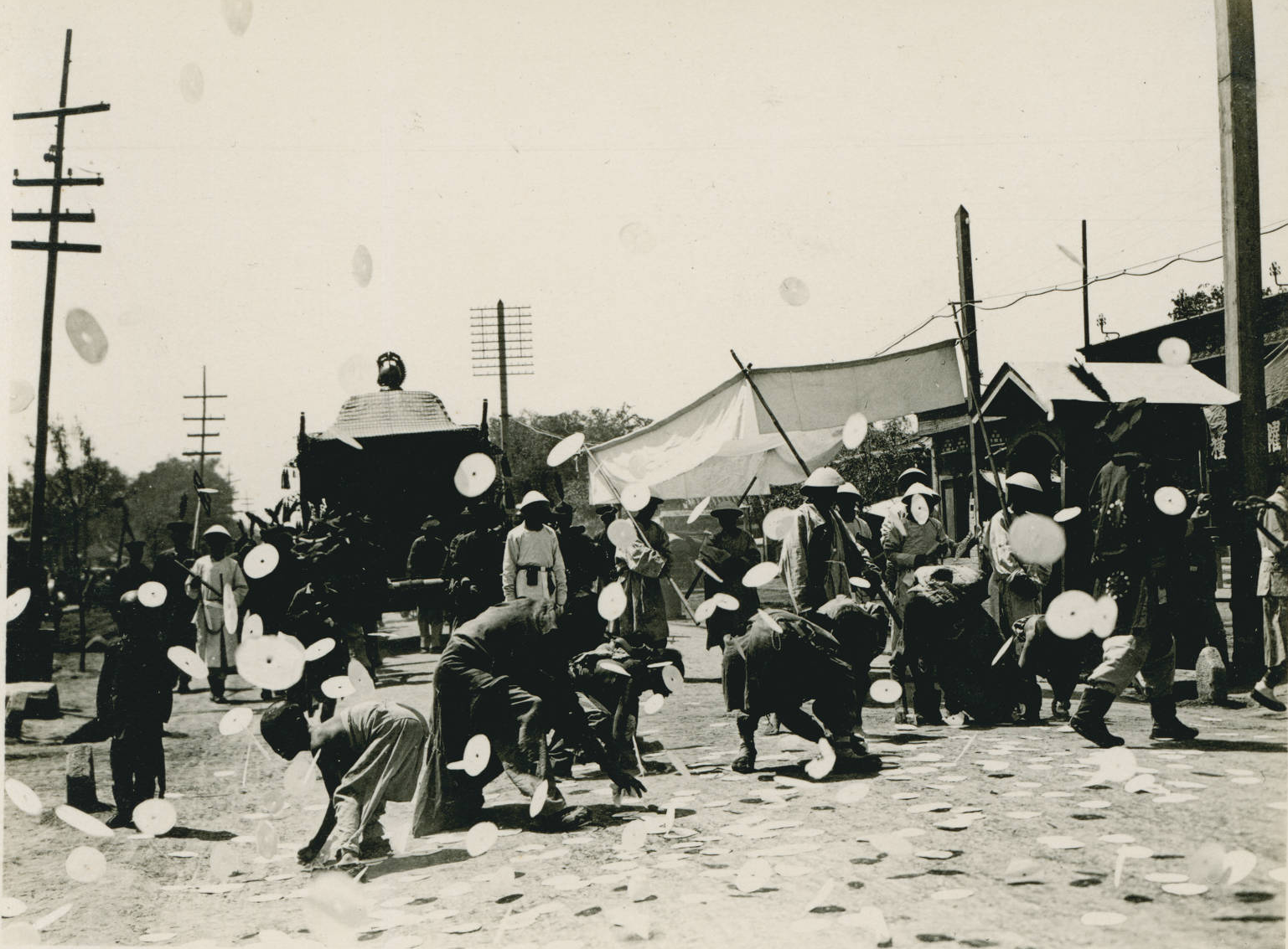 Funeral procession white cardboard discs thrown into the air, 1909-05