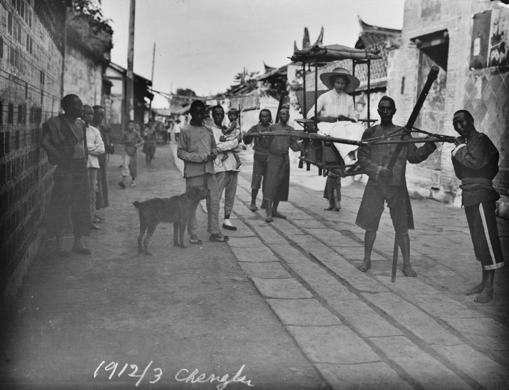Hedwig Weiss in her litter on the road leading to the consulate, March 1912, Chengdu