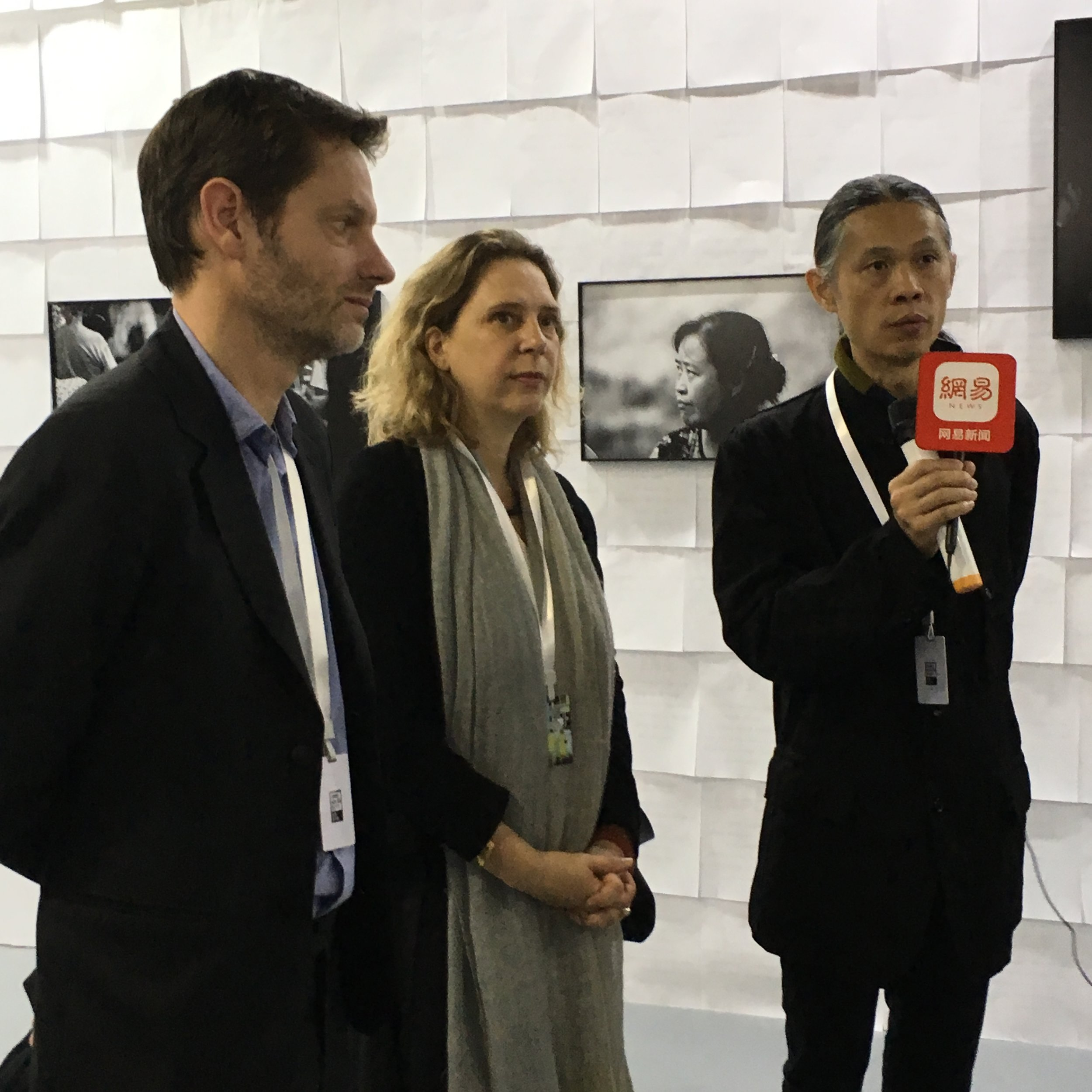 Festival preview before public opening, exhibition tour with (from left to right): Sam Stourdzé, Bérénice Angrémy, Rong Rong © Marine Cabos
