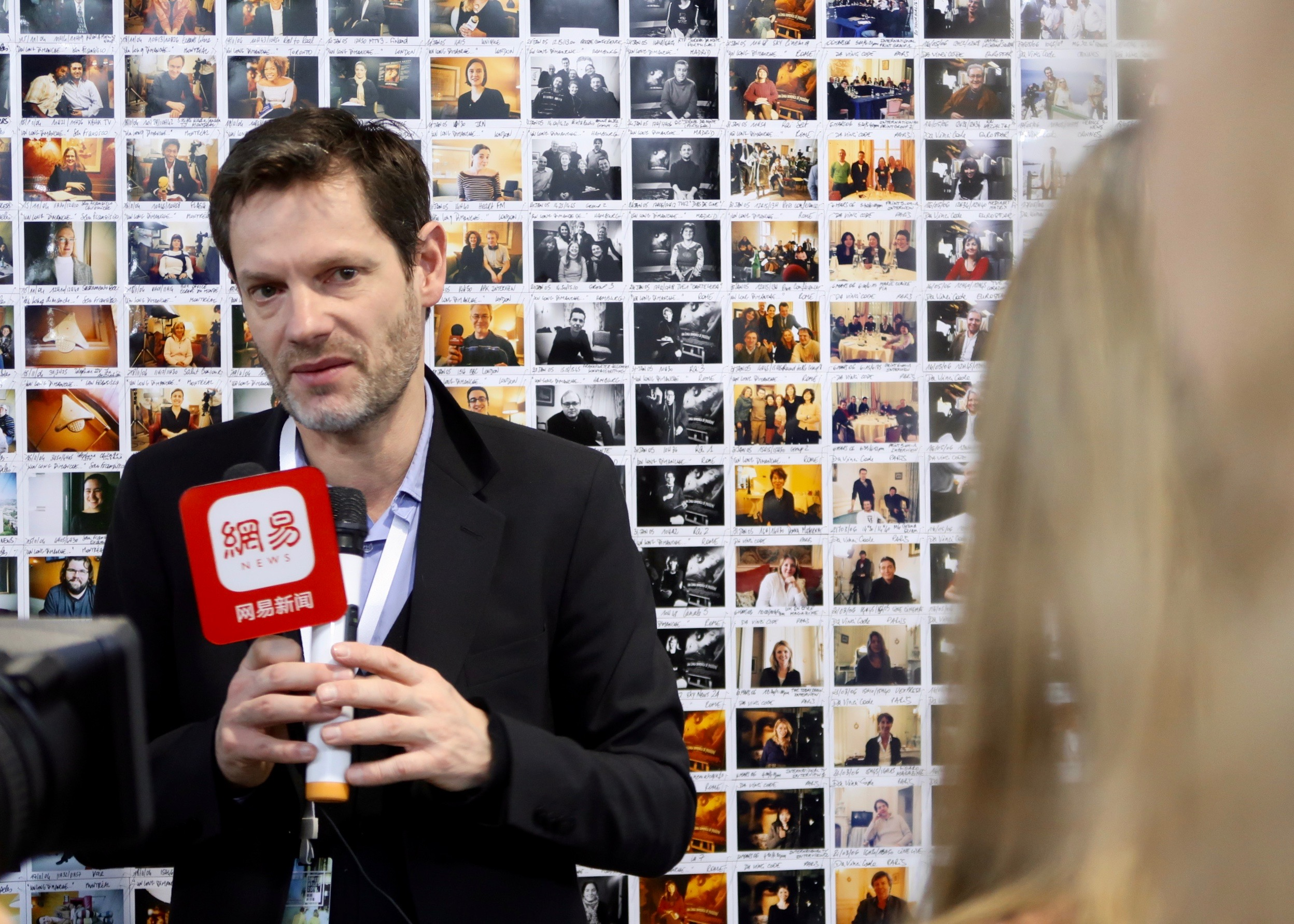 Sam Stourdzé speaking to local media at Jimei Citizen Square main exhibition hall © Marine Cabos