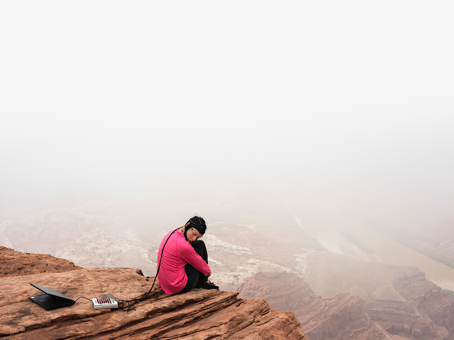 """Lucas Foglia,  Kate in an EEG Study of Cognition in the Wild , Strayer Lab, University of Utah, Utah 2015. Courtesy of Michael Hoppen Gallery. (""""On Earth - Imaging, Technology and the Natural World"""" exhibition to be on display at Jimei this Fall)."""