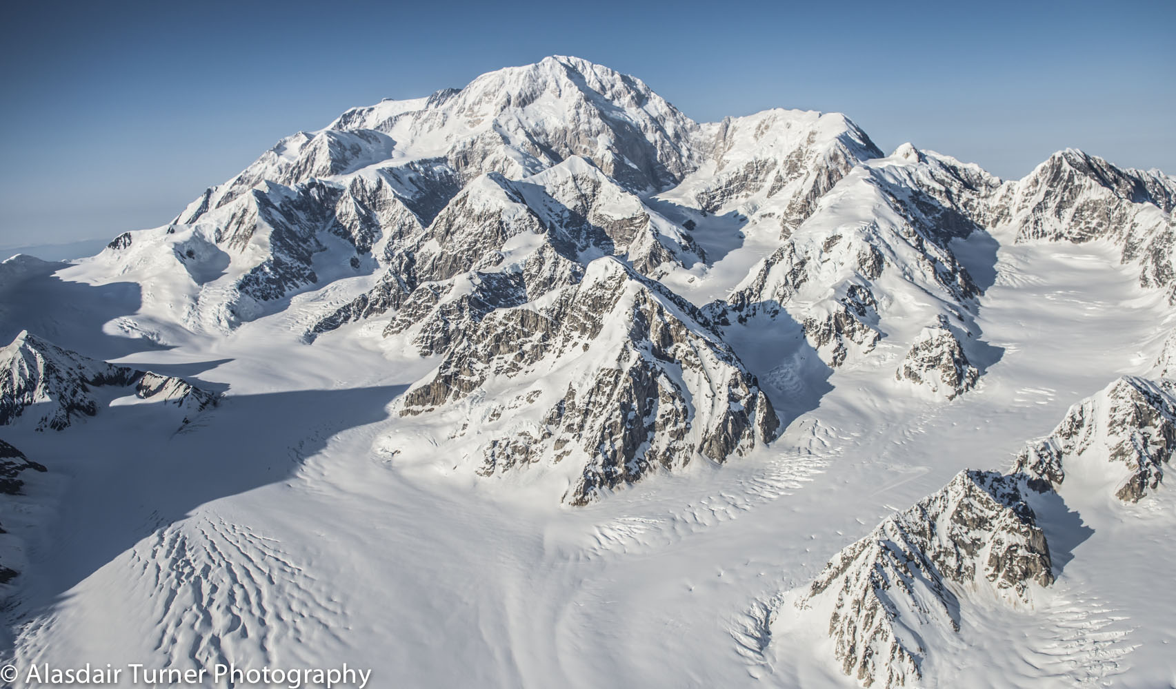 Denali, and the Kahiltna Glacier as seen from 12,000 feet. This is not a view that is seen very often since most people are at a much lower altitude when they get to this area. I love this shot since it really shows Denali as a individual mountain in a way I have not seen before. It also contains the entire West Buttress route up the Kahiltna Glacier which is also rare to see in a photo. Click on the image to purchase.