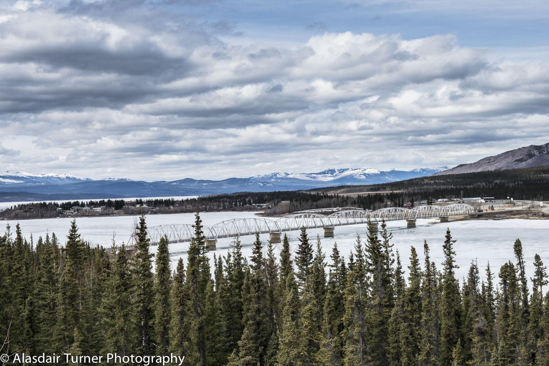 Crossing the still frozen Yukon River.