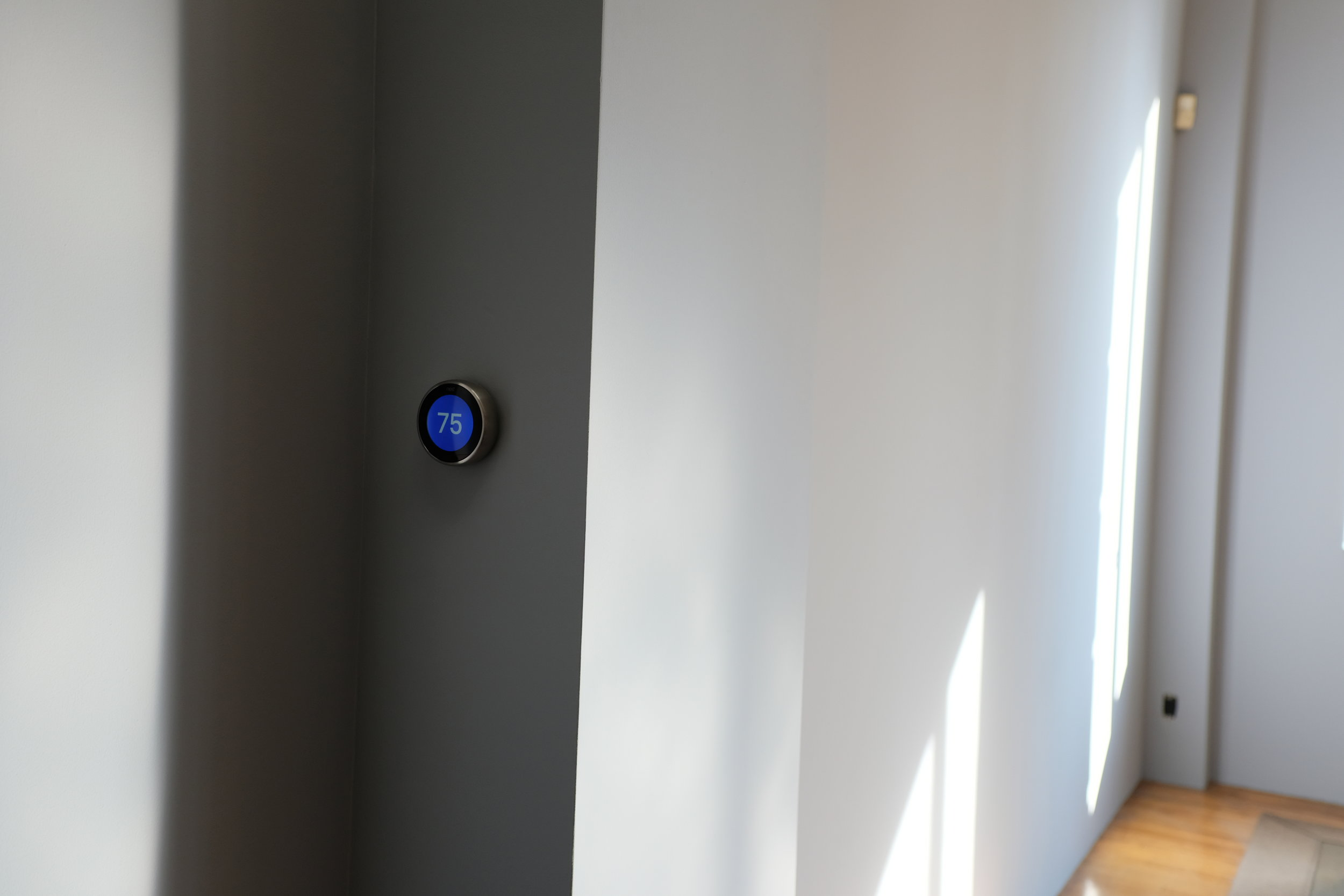 Sleek and discrete Nest thermostat intuitively controls your home's temperature.
